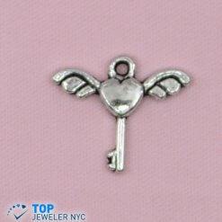 Wings Key shape steel Pendant Silver plated.